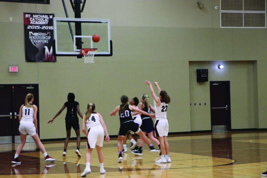 LASA+freshman+Jessie+Conolly+boxes+out+for+an+opposing+free+throw.+The+lady+jaguars+played+on+Nov.+27+against+St.+Michaels+Academy+in+a+18-60+loss.+photo+by+Elan+McMinn