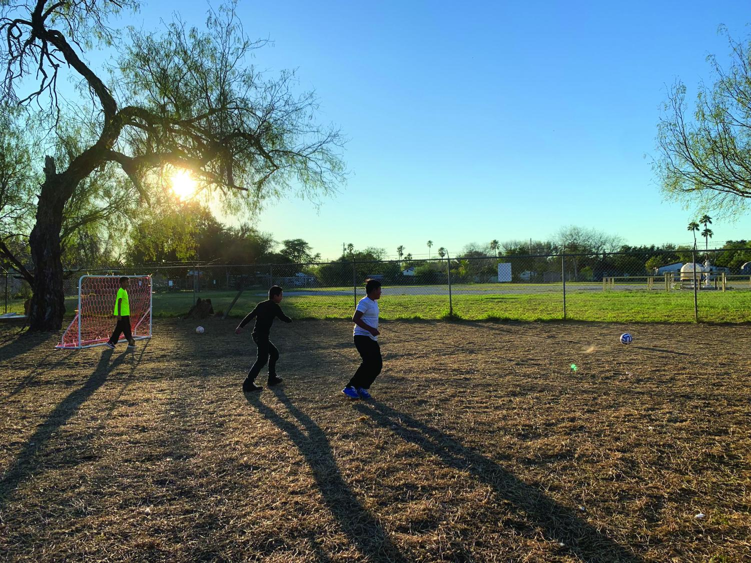 Children at the Rio Grande Valley branch of Catholic Charities play a game of soccer. Senior Ava Ponder helped to set up the new soccer equipment during her trip. photo courtesy of Ponder