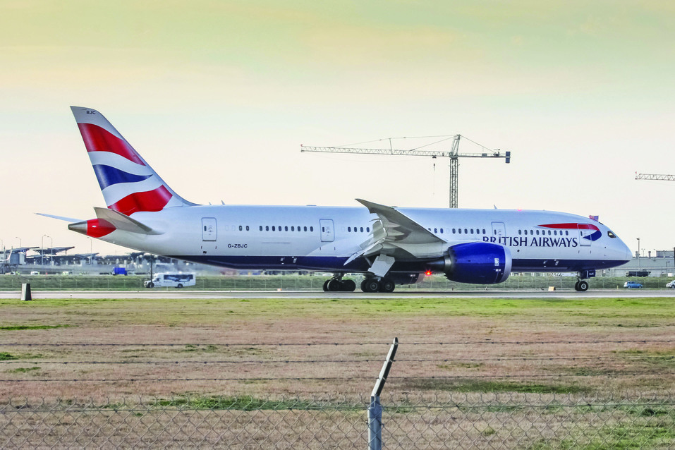 British Airways' first flight landing in Austin in 2014 with the cockpit crew waving an American flag in celebration of the new route connecting Austin and London Heathrow. The airline began flying to Austin with the Boeing 787 and now services the route with a 747-400 during the summer and 777-300ER during the winter season. photo by Mateen Kontoravdis