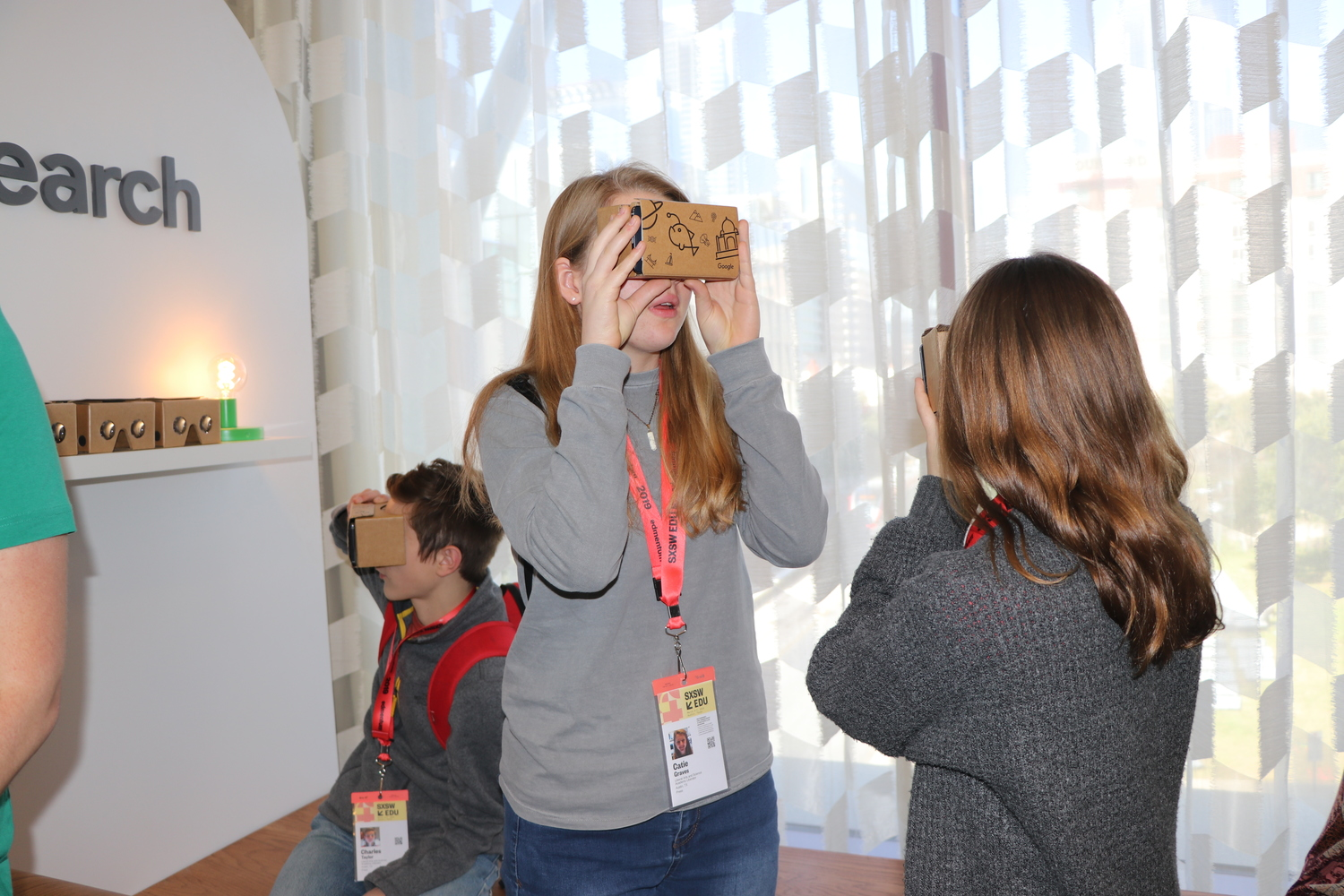 Sophomore Charles Taylor and freshmen Emma McBride and Catie Graves (left to right), Liberator staff writers, try on Google VR that depicted environmental causes. photo by adviser Kevin Garcia