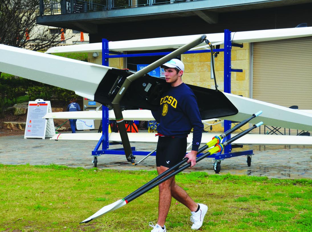 Senior Thomas Wilson prepares his boat and oars. photo courtesy of Thomas Wilson